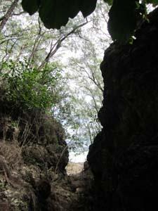 Passage ascending through rocks to Ava Tapu - Atiu